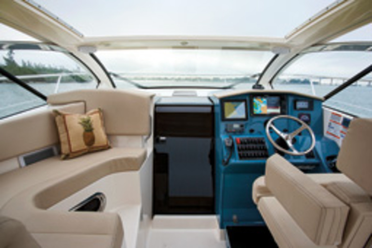 The Pursuit's dark helm reduces glare, and the obstruction-free windshield is one of the boat's notable characteristics.