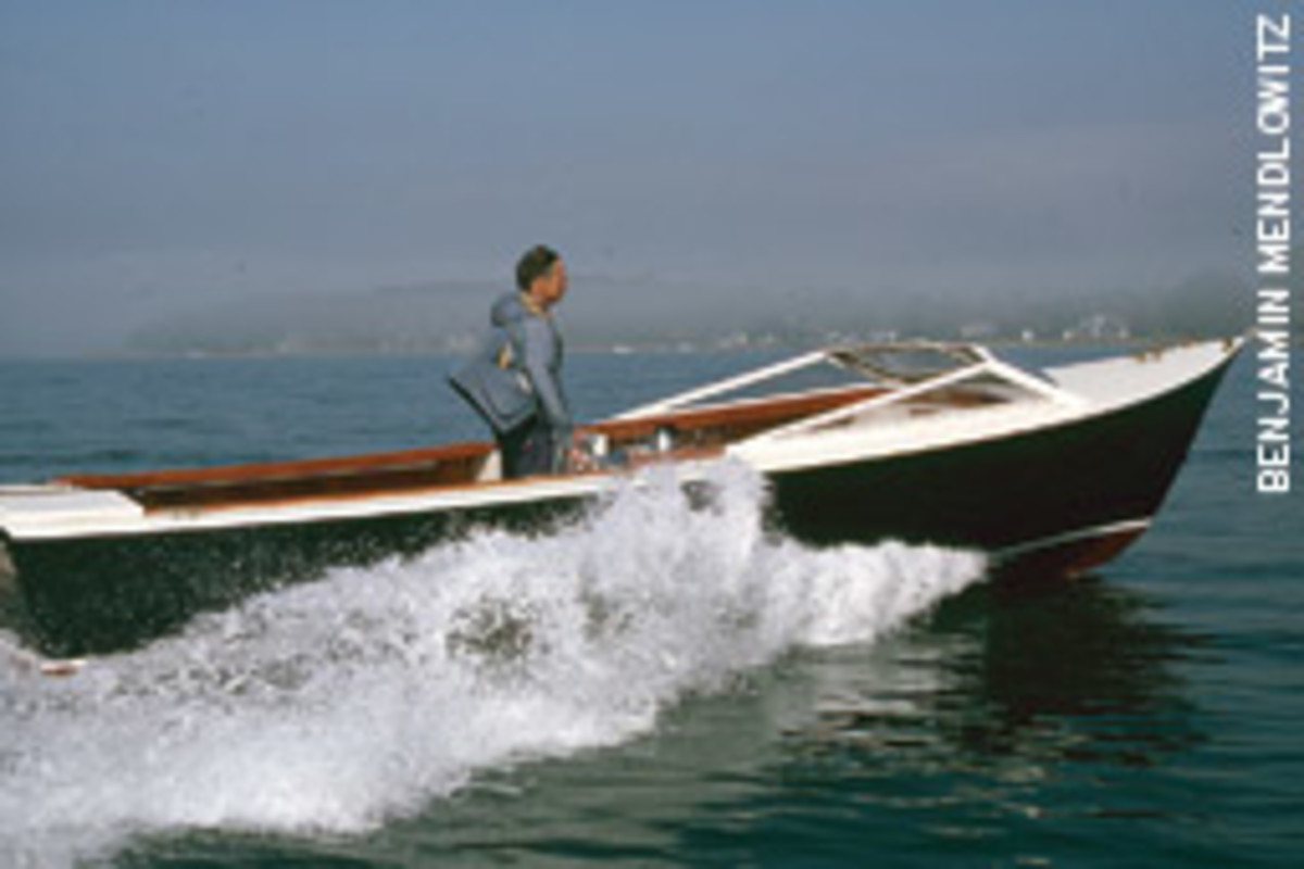 Bolger designed the narrow 25-foot outboard launch TarTar for lightweight cold-molded construction.