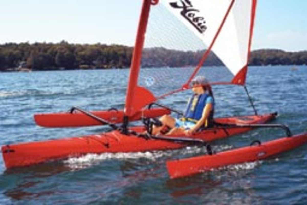 Hobie's Mirage Adventure Island is a kayak that can be paddle or pedaled - outfitted with amas for sailing.