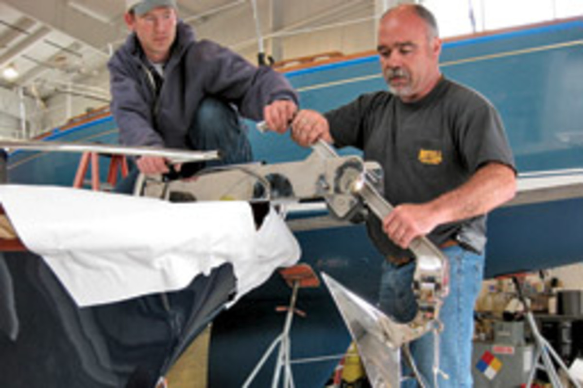 Bob Butler, left, of Noank Village Boatyard, and Charlie Marques from Mystic Stainless and Aluminum work on the project.