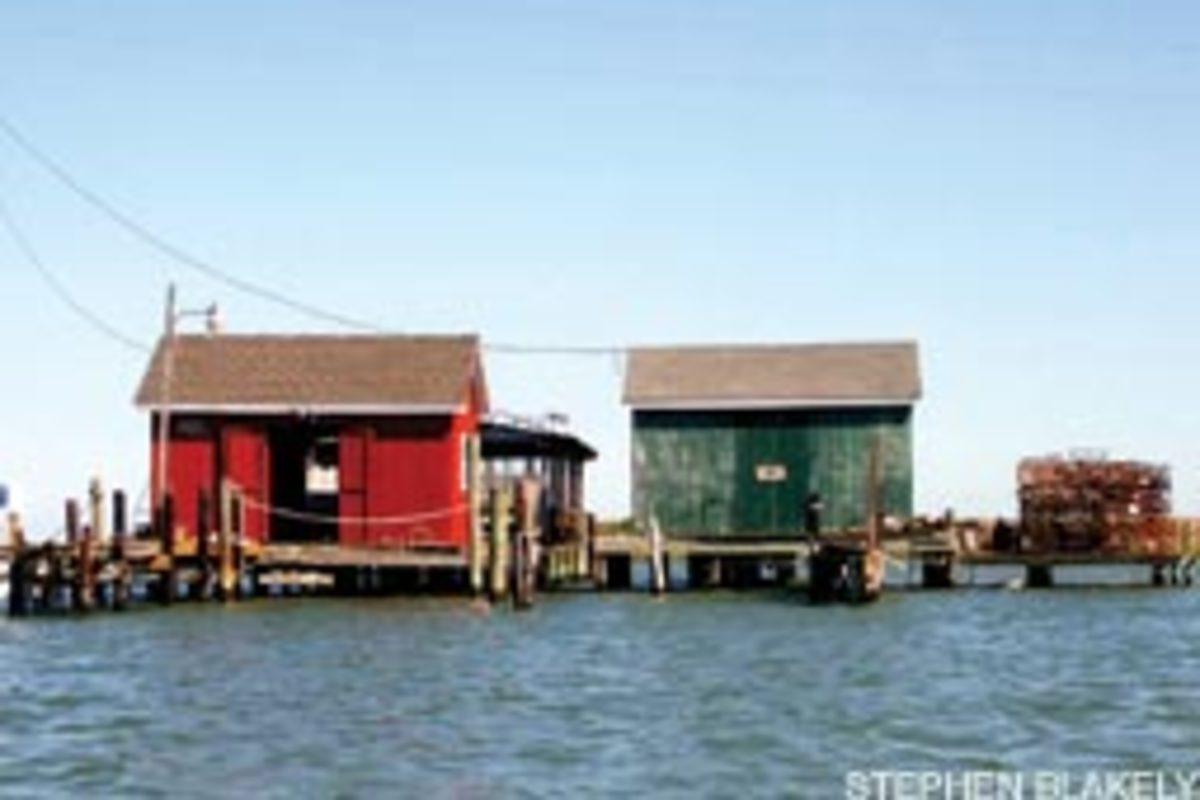 Dozens of crab shanties dot Mailboat Harbor.