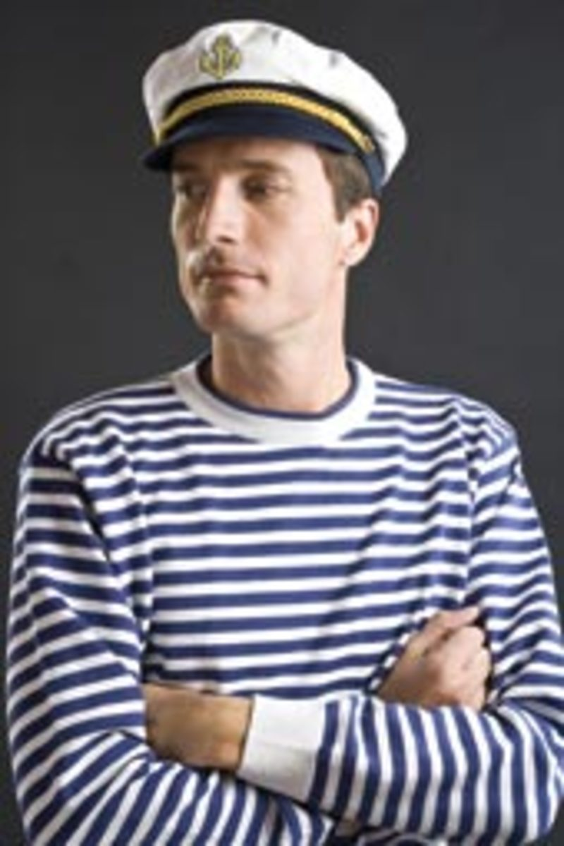 Traditional 'Yachtie-like' sweater and captain's hat.