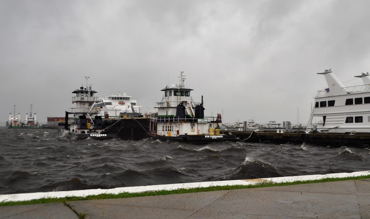 Large commercial vessels, including two huge barges, provided an impromptu breakwater that protected boats docked to the south of them.