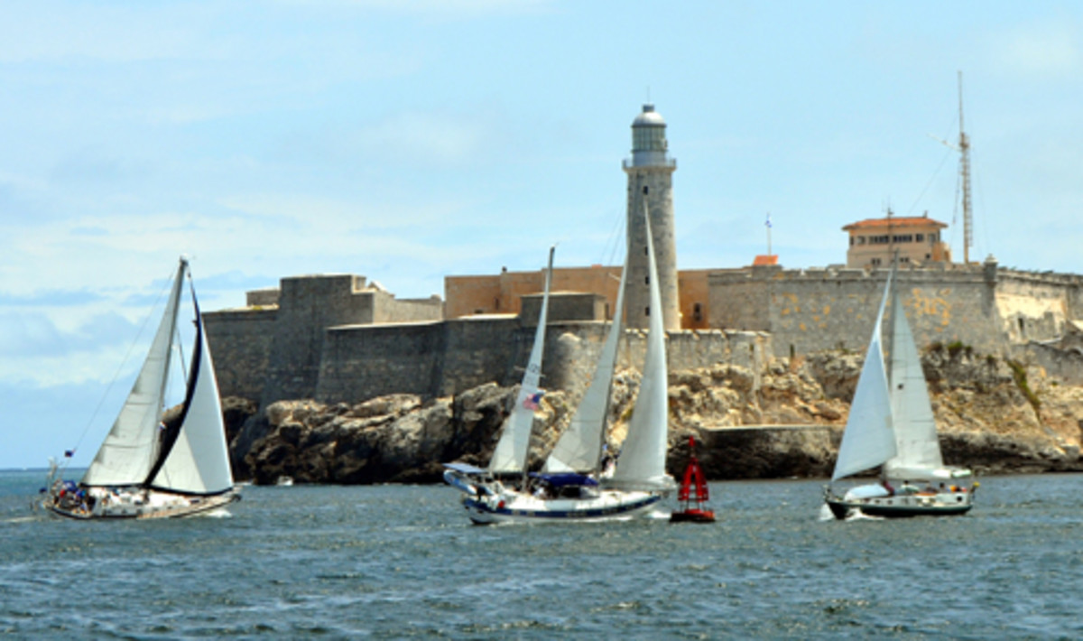 This image, shot in 2011, shows a regatta under way outside Havana Harbor. Defying the travel ban, American boats round a mark in front of Morro Castle.