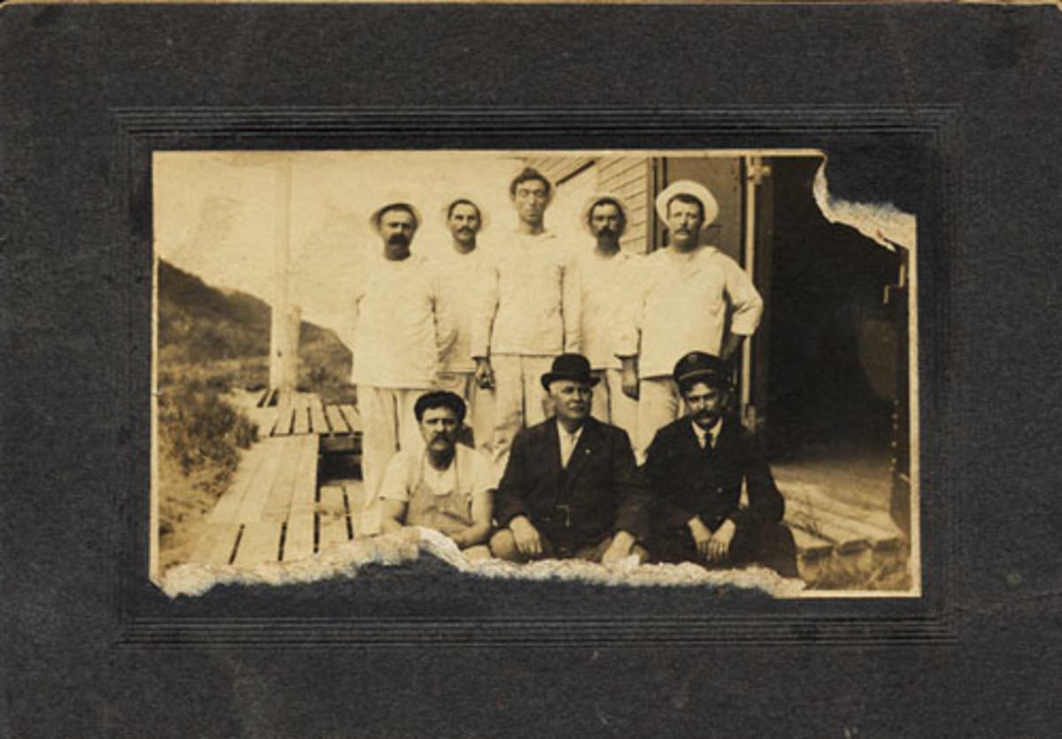 W. Bernard Sisson (center, standing).