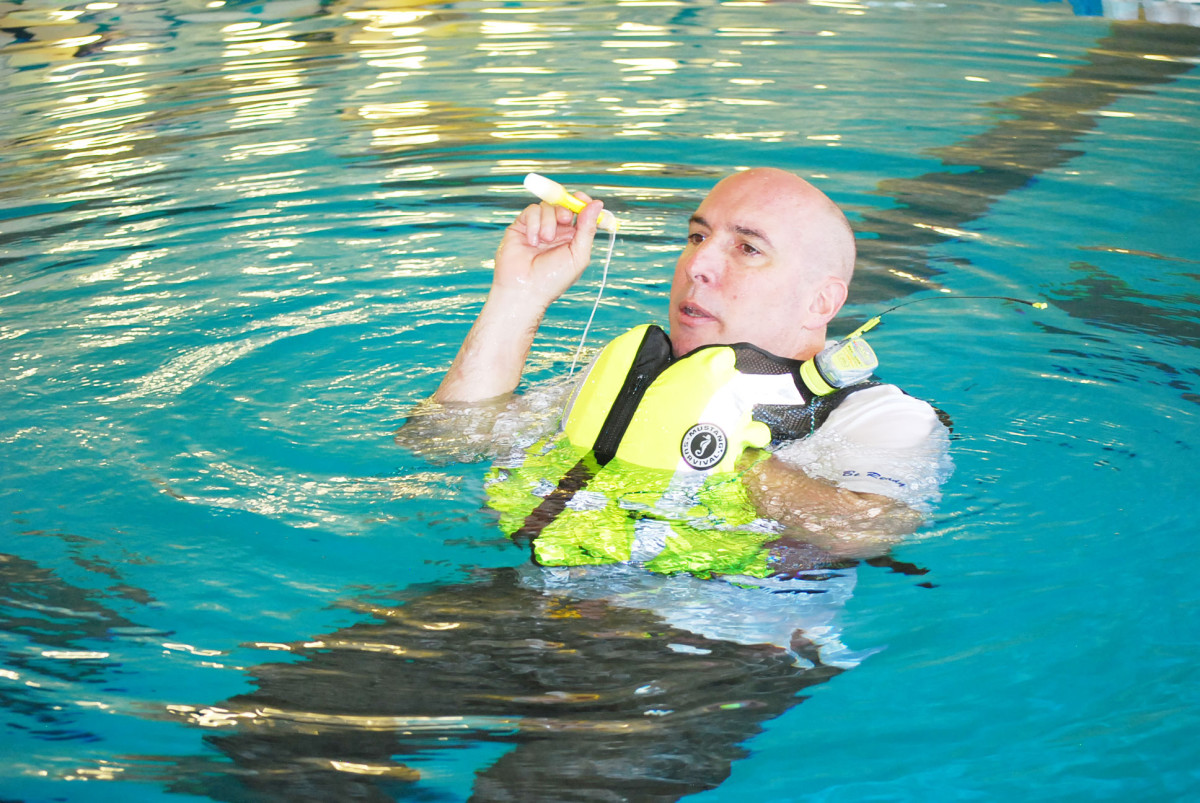 Vittone teaches the proper use and setup of life jackets and signaling devices.