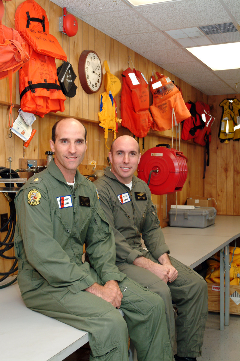 "Helicopter pilot Dan Molthen (left) and rescue swimmer Mario Vittone. Photo by Martha Laguardia Kotite, author of ""So Others May Live"" marthakotite.com"