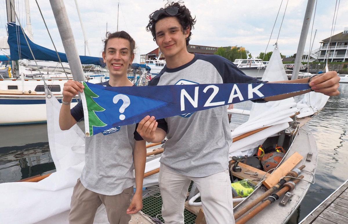 N2AK Crew members displaying their flag