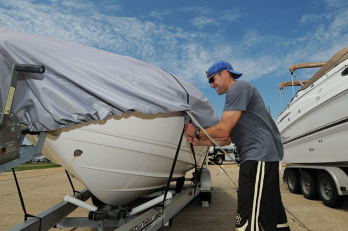 Tying your boat to its trailer helps prevent it from floating away in the flood waters a hurricane can bring.