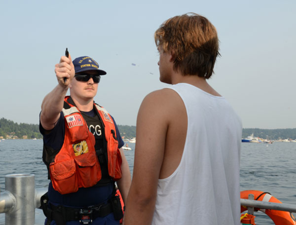 A Coast Guardsman performs a field sobriety test. Drunk passengers and skippers can create havoc on board.