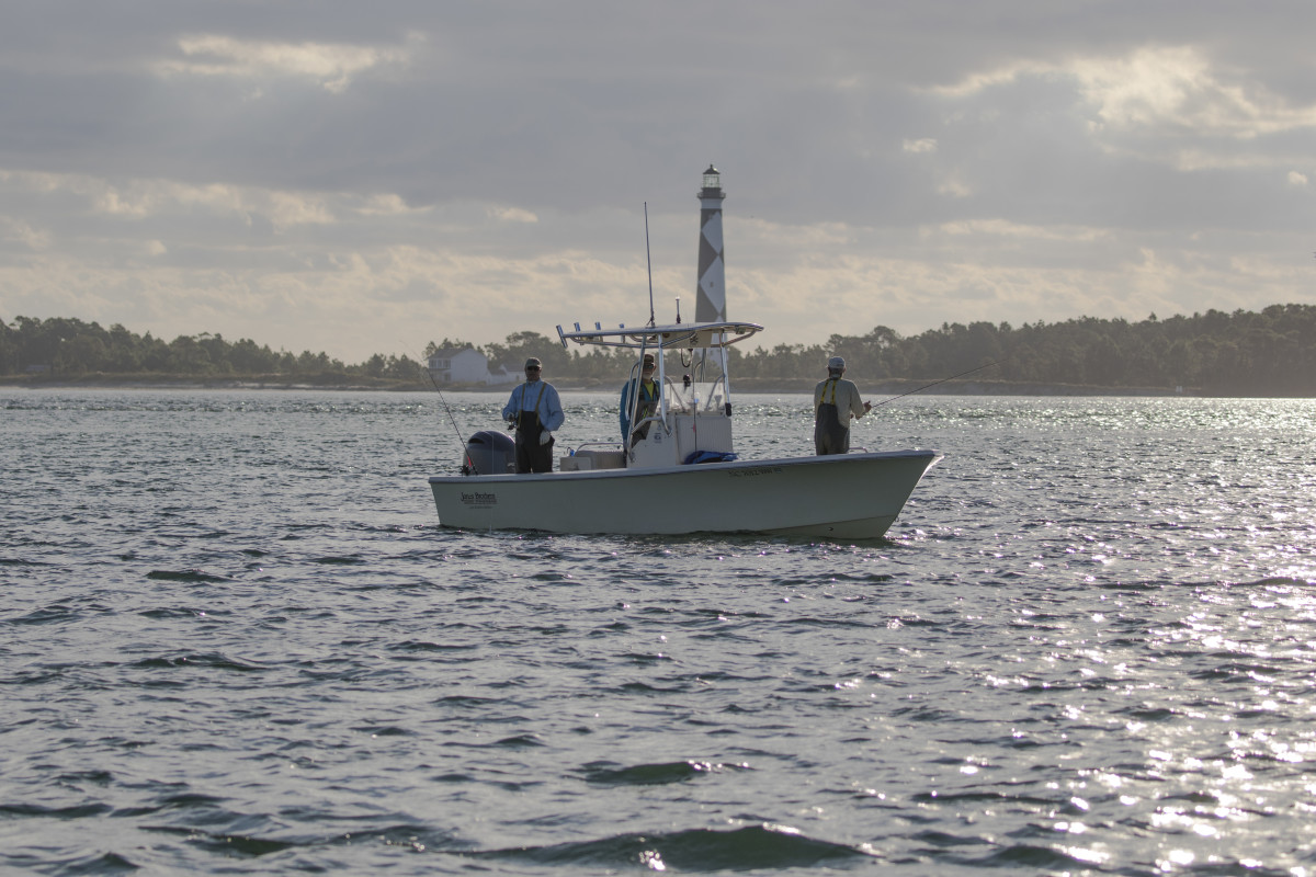 A fishing captain with two clients near Cape Lookout, North Carolina.