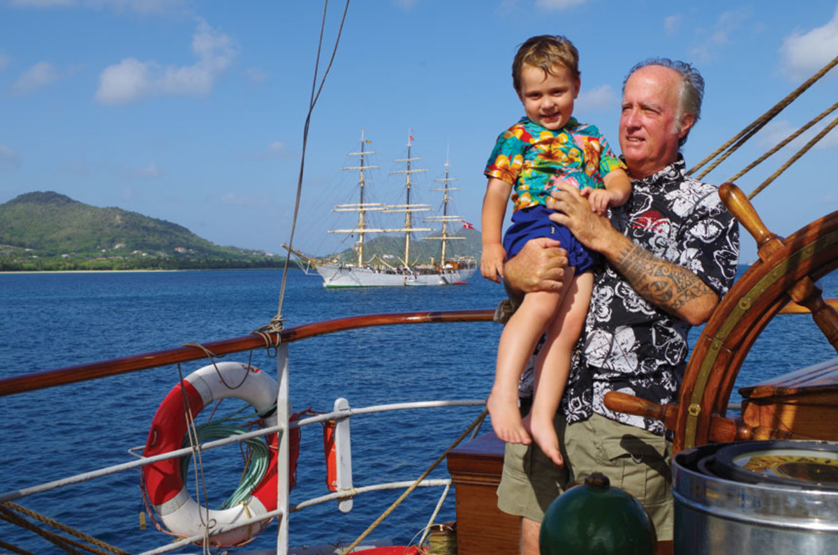 Capt. Dan Moreland and his son, Dawson. Anchored in the background is the Danmark, the Danish full-rigger Moreland sailed for four years as bos'un.