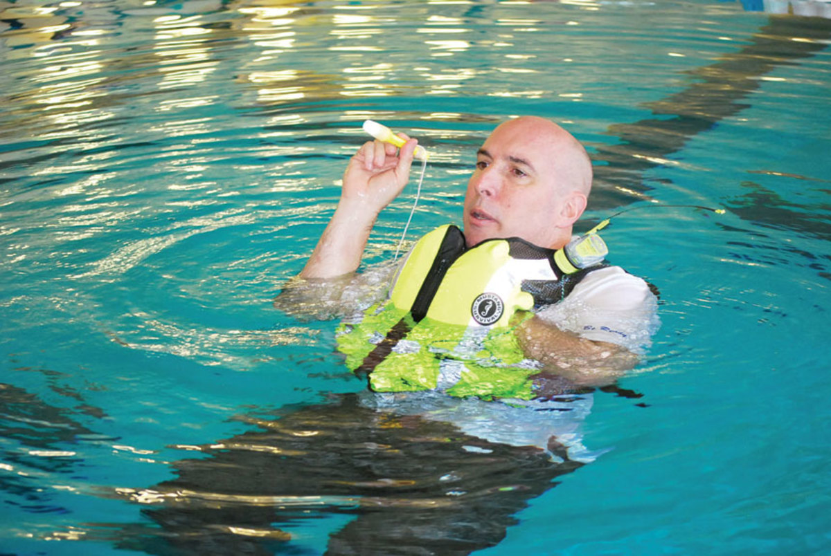 Mario Vittone teaches the proper use and setup of life jackets and signaling devices.