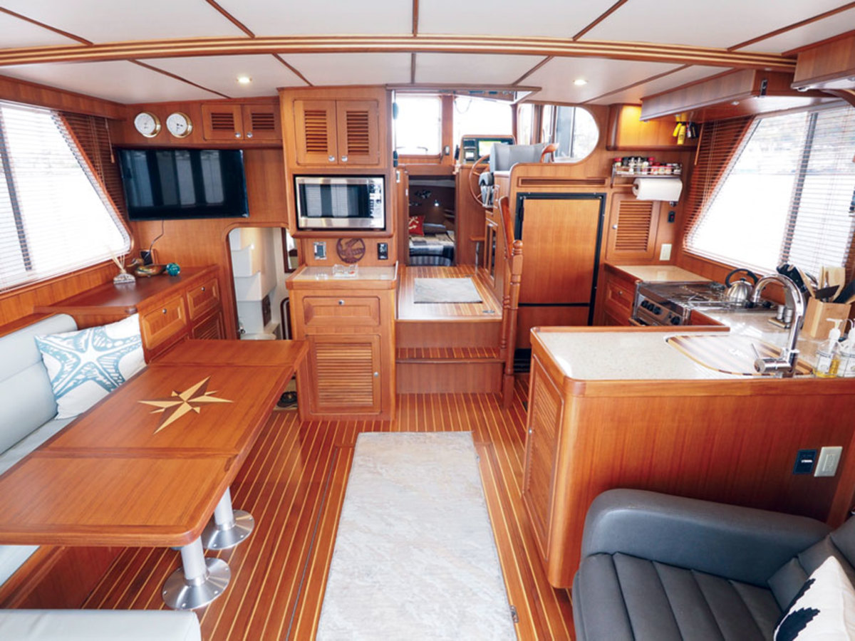 A bright, well-positioned galley puts the cook between the helmsman and those in the  main saloon.