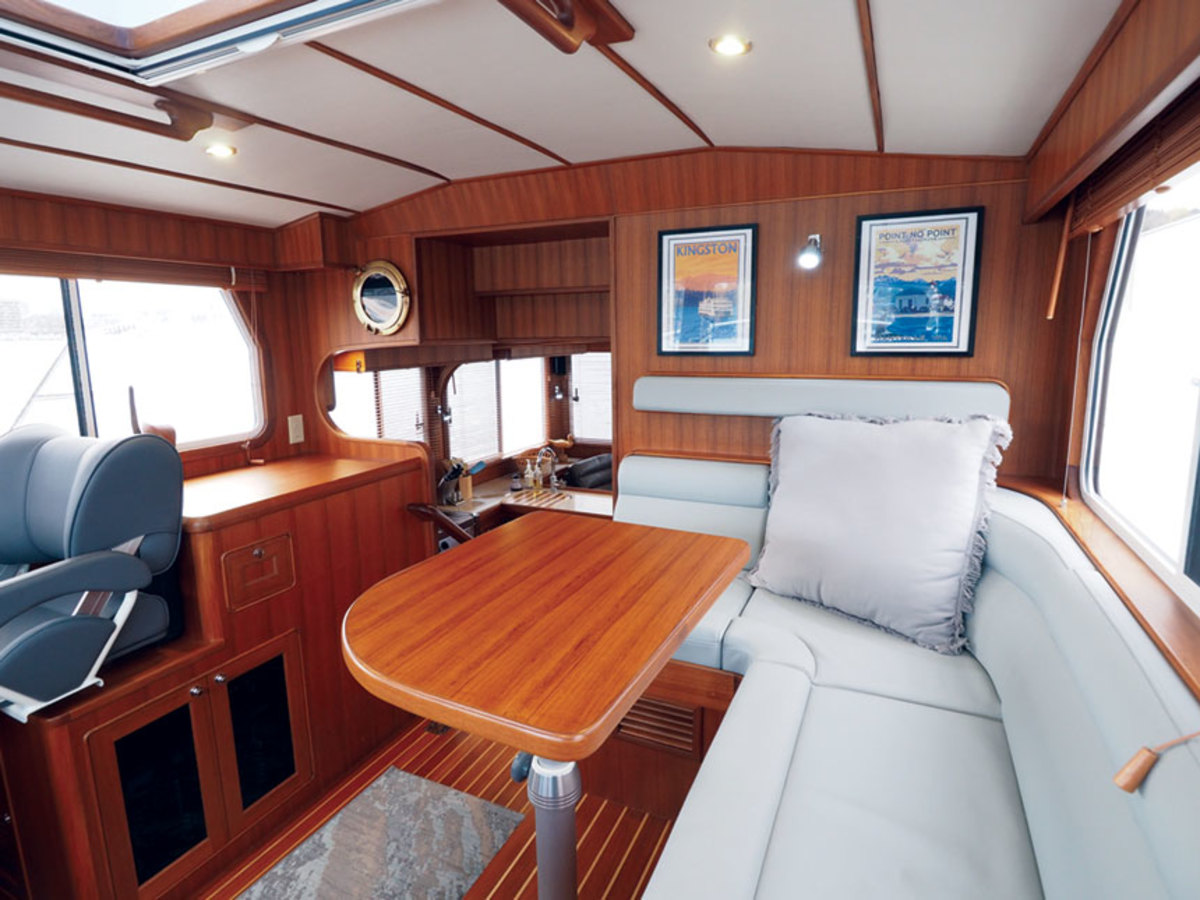 The Helmsman 38E's pilothouse has an L-shaped lounge with plenty of space for guests.
