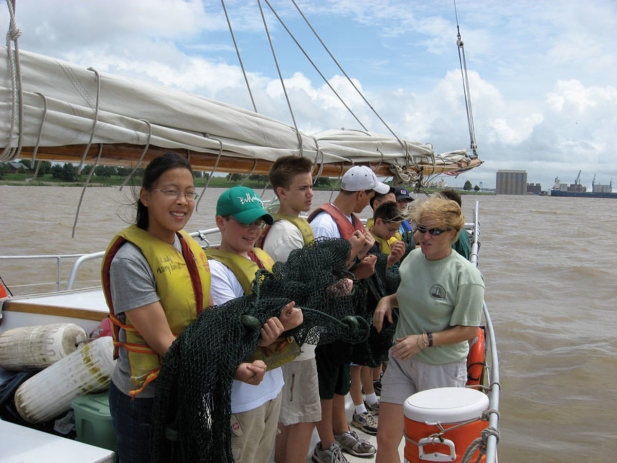Students prepare to deploy the otter trawl aboard Minnie V.