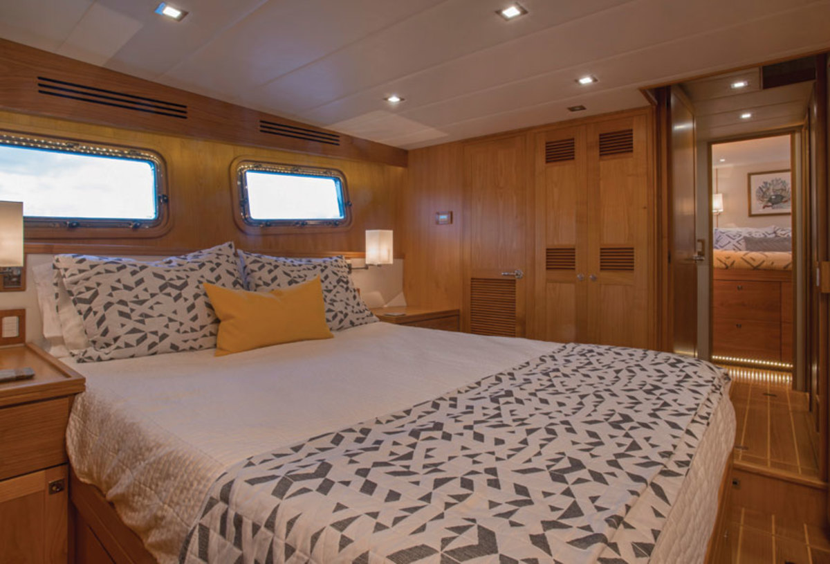 A midship master stateroom with a queen island berth has drawer stowage below, floor length hanging lockers, twin sinks and a large enclosed shower in the ensuite head.