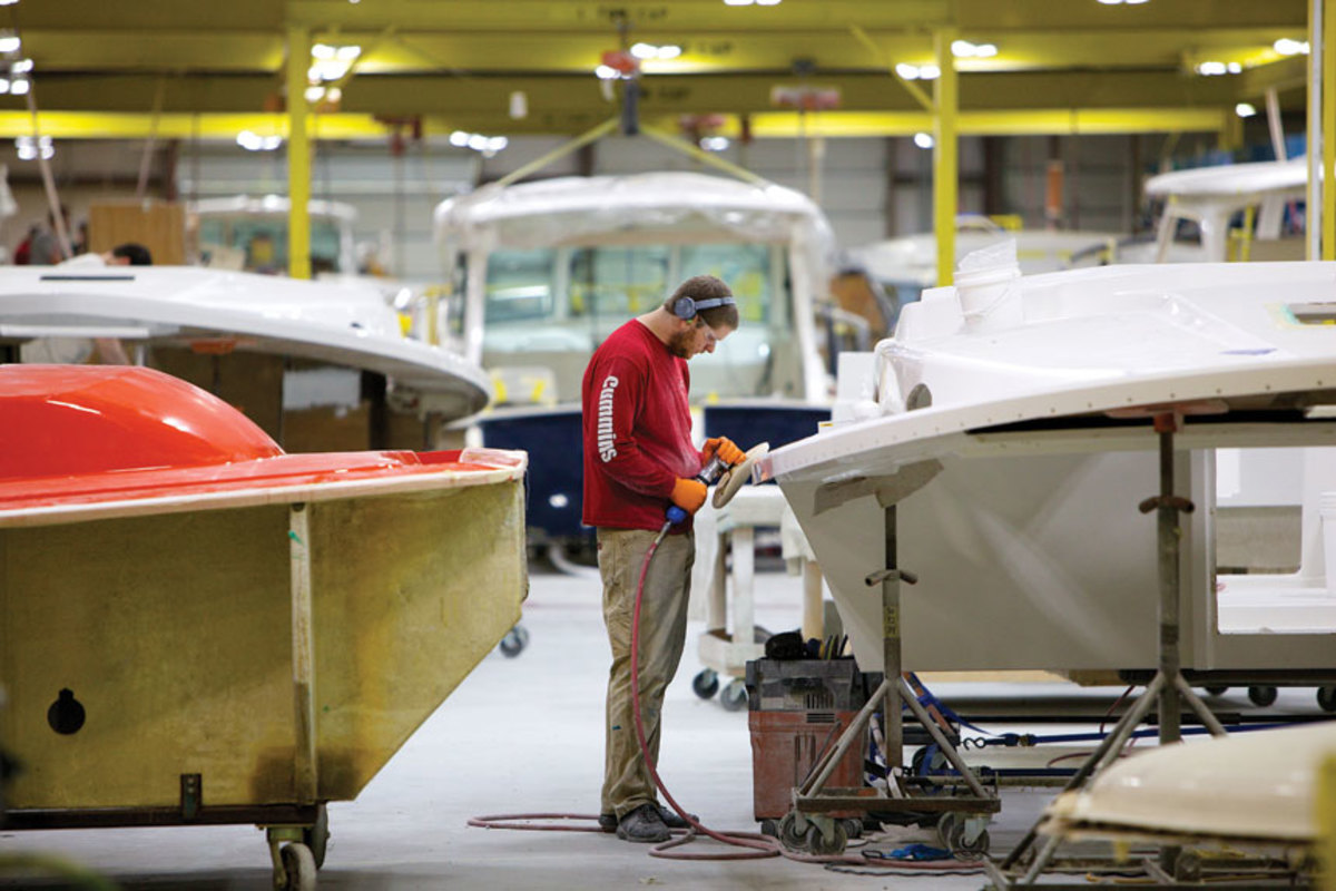 A workman at Back Cove's Rockland facility polishes the deck for the very first Back Cove 34O.