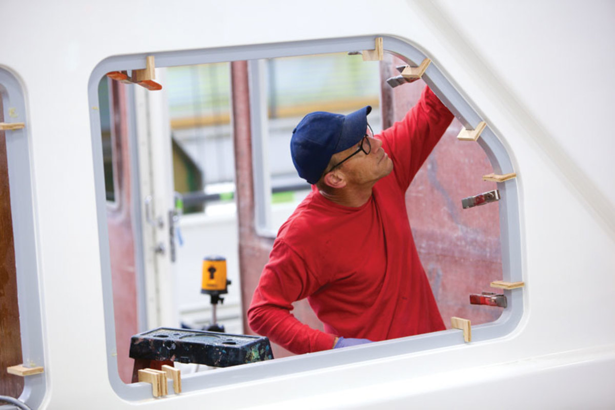 An employee works on the 94-foot Paragon Motor Yacht refit.