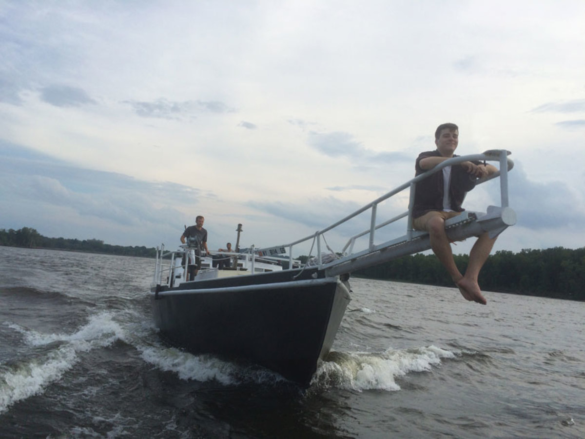 Damon Stewart-Souris enjoys a ride on the bow pulpit as Apollonia  motors to Hudson, New York.