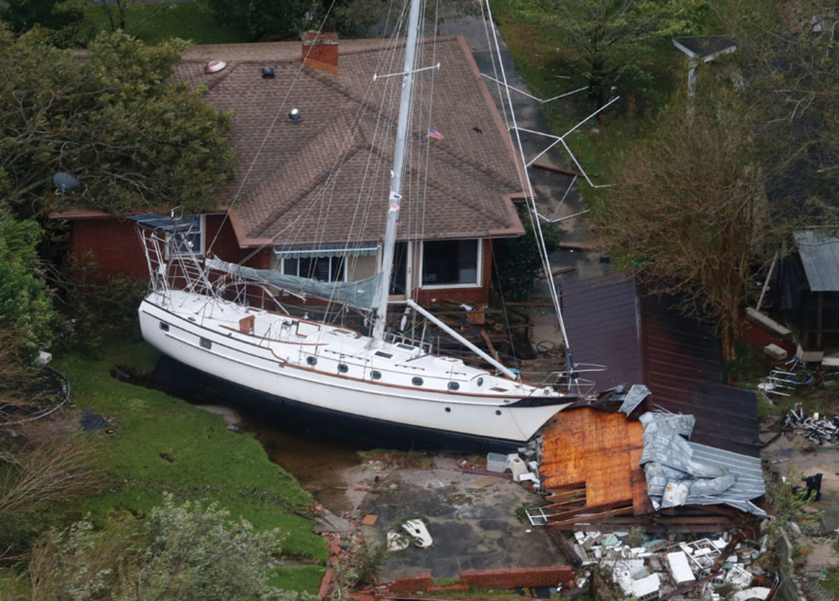 A sailboat rests against a  collapsed garage in New Bern.