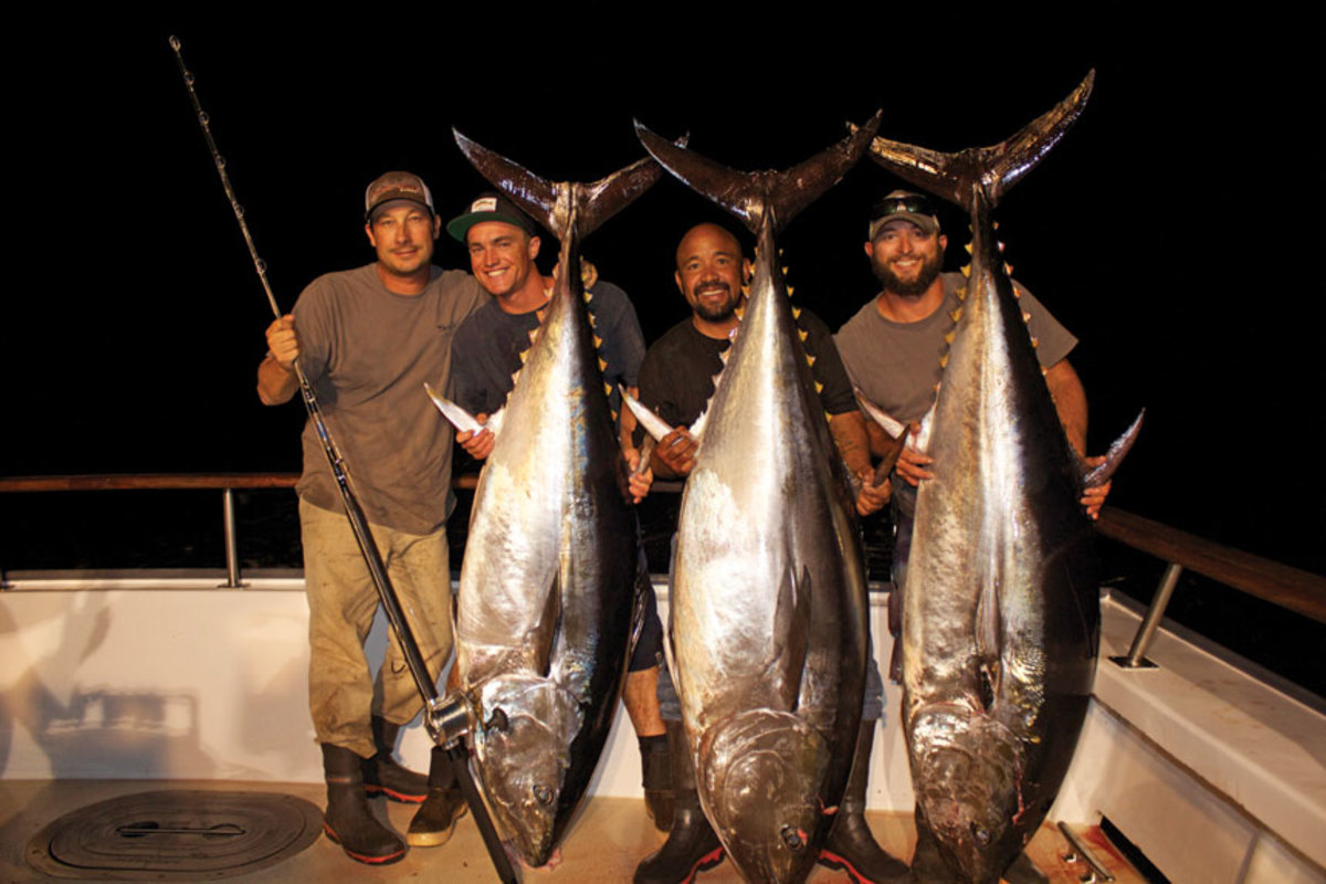 Capt. Pat Cavanaugh (left) and the Pacific Dawn crew with three 200-plus-pound bluefin tuna
