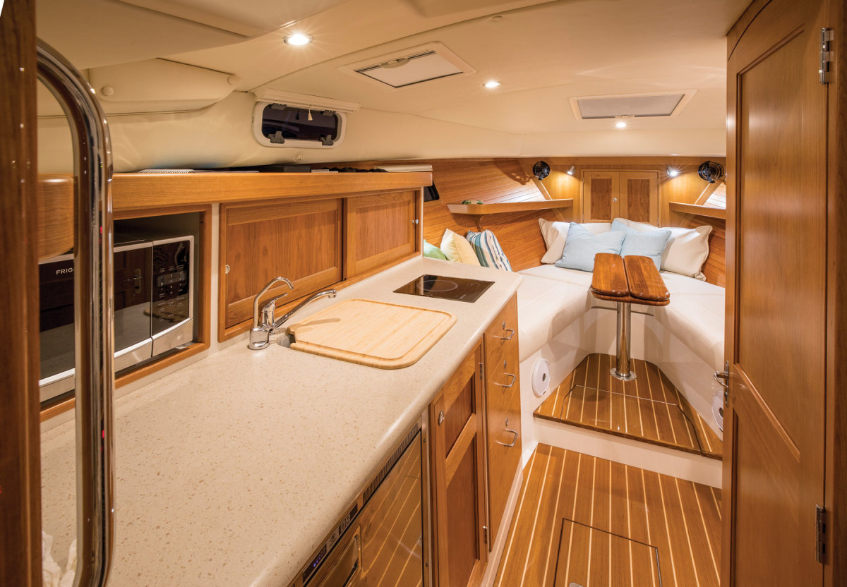 Below, there's a V-berth forward, a wet head to starboard and a galley opposite. Stowage spaces are plentiful throughout the 35z.