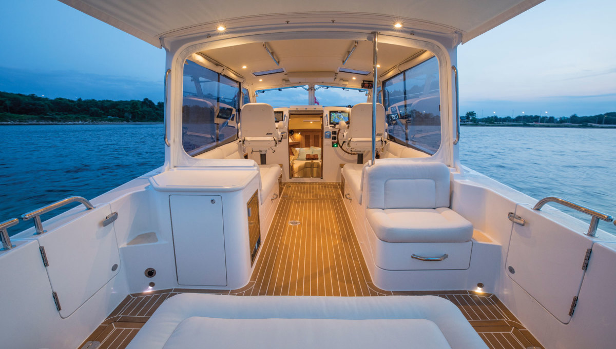 The main deck has Stidd seats that pivot to face aft and lower to create berths. Large sliding side windows and optional power-operated windshield panels open to the elements in fair weather.