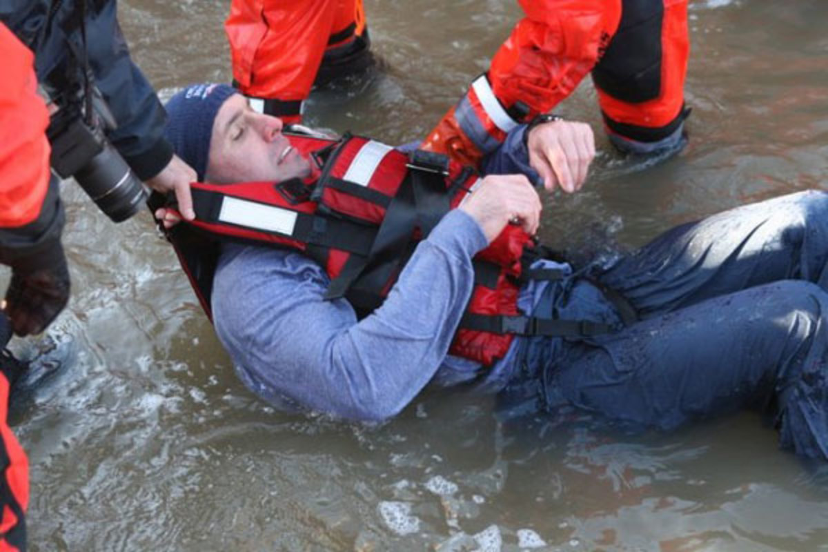 The author being pulled from 44-degree water during the filming of Cold Water Boot Camp.