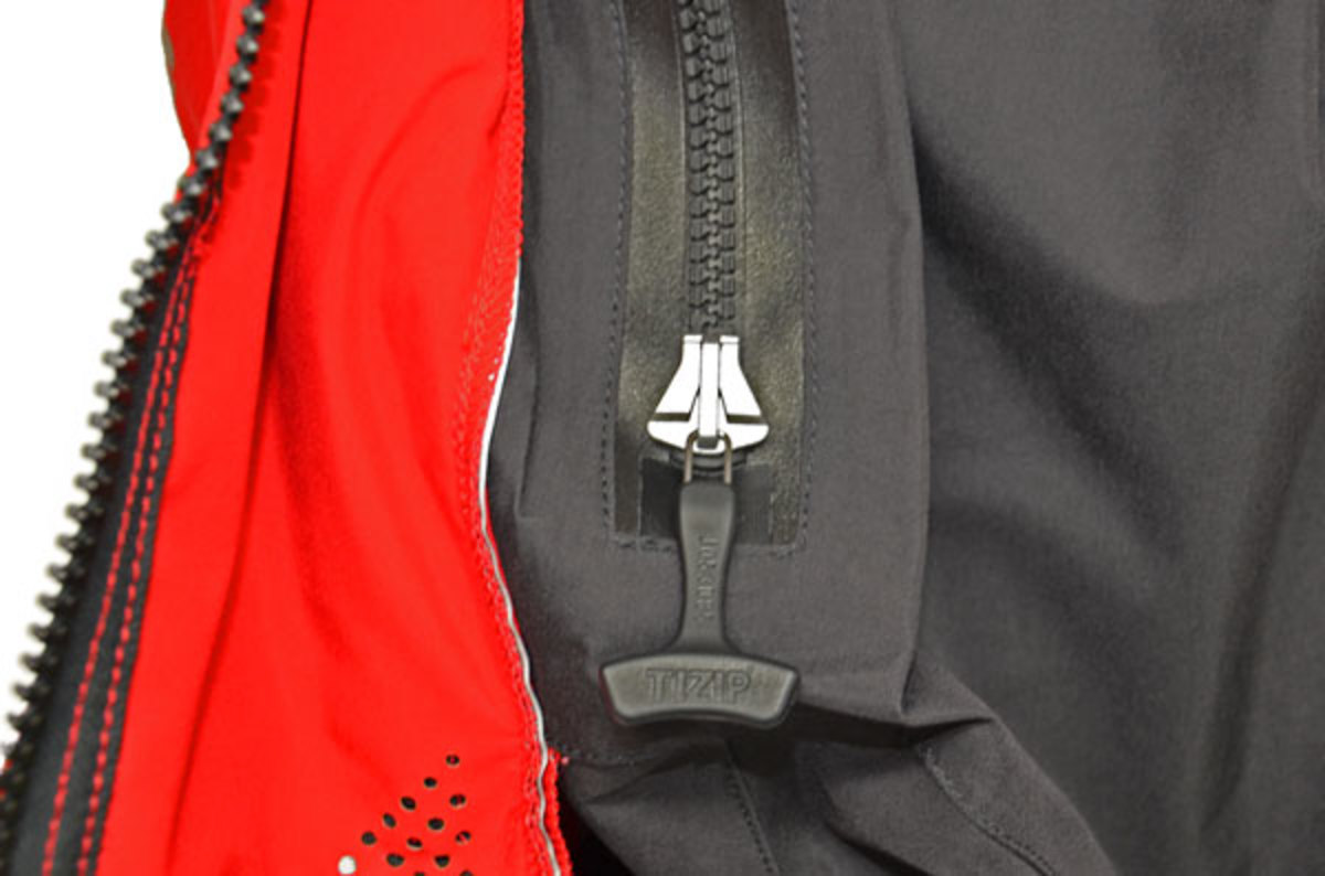 The watertight seal is made by the pressure of the teeth being squeezed against one another when the zipper is closed.