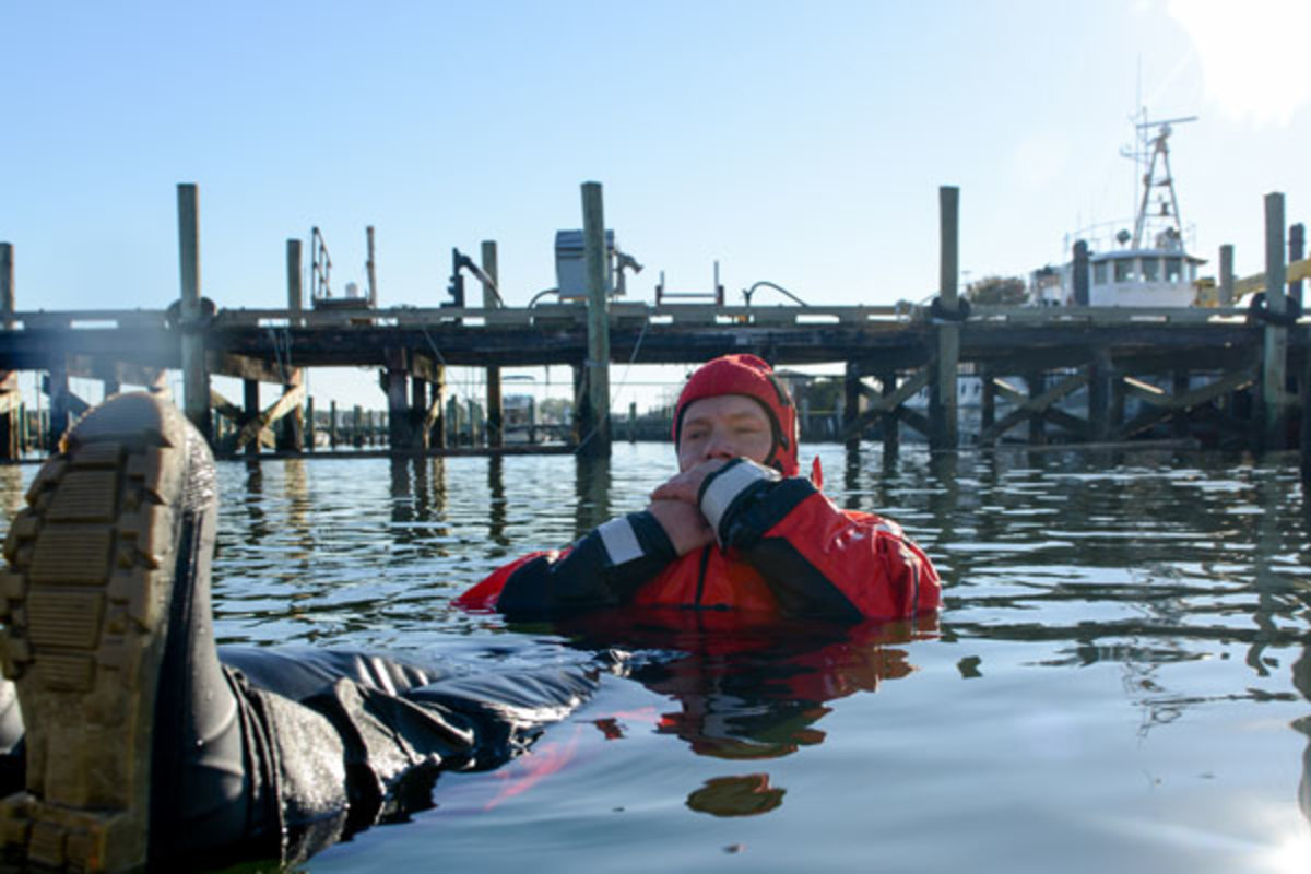 Wearing a properly fitted dry suit with insulation can stave off hypothermia.