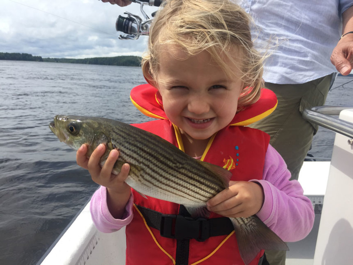 The writer's daughter knows the best excuse for being out on the water is fishing for striped bass.