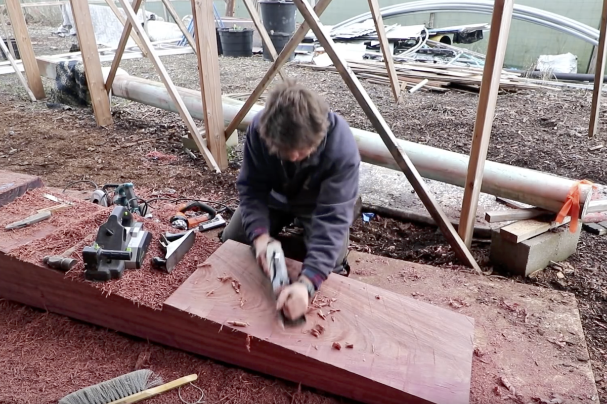 Leo Goolden shapes a scarf joint into a massive piece of purpleheart.