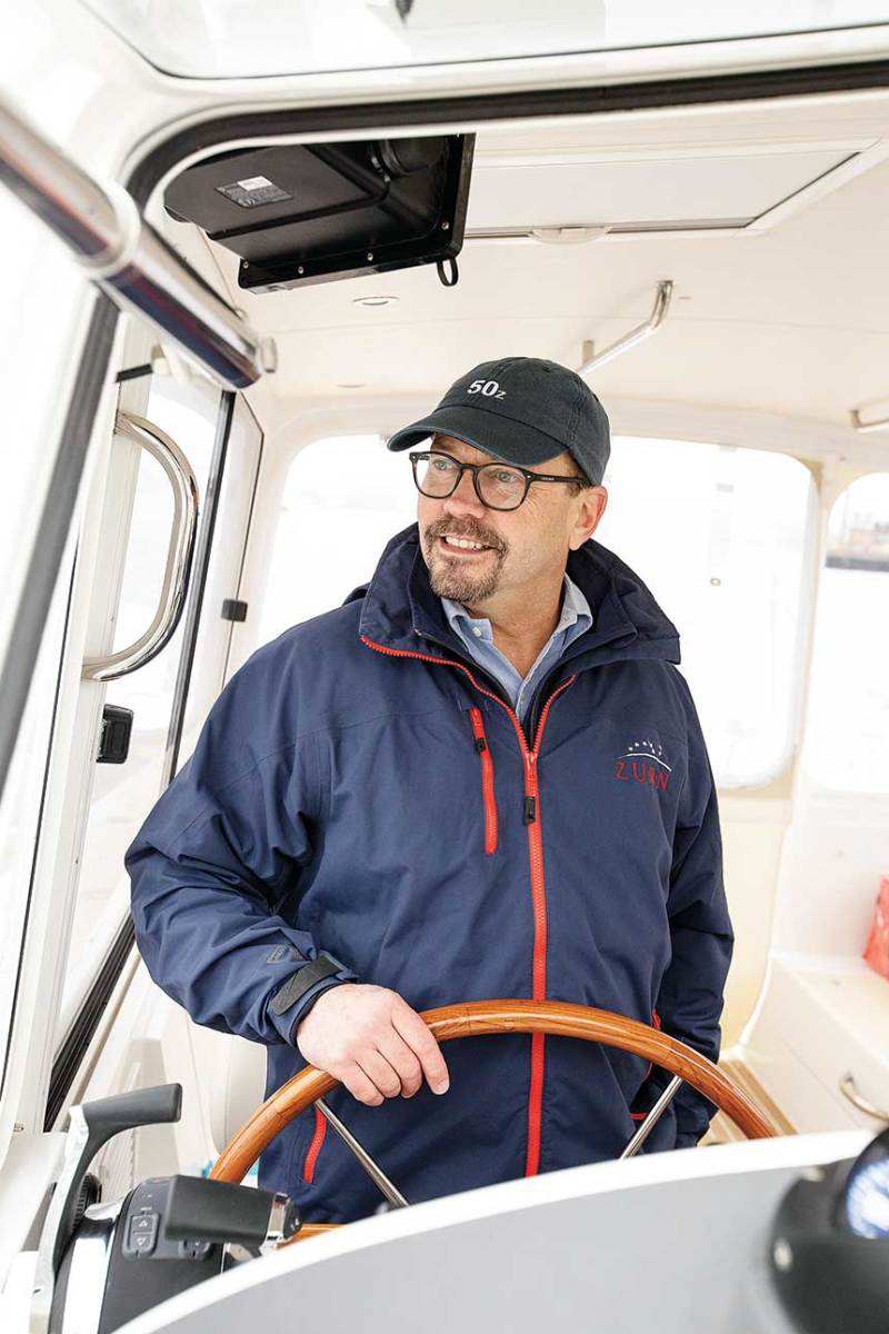 Zurn at the helm of an MJM; he's designed six boats for the company.