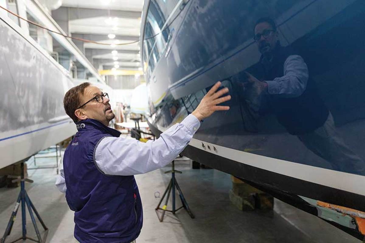 Zurn checks the fit and finish of a yacht under construction in Boston