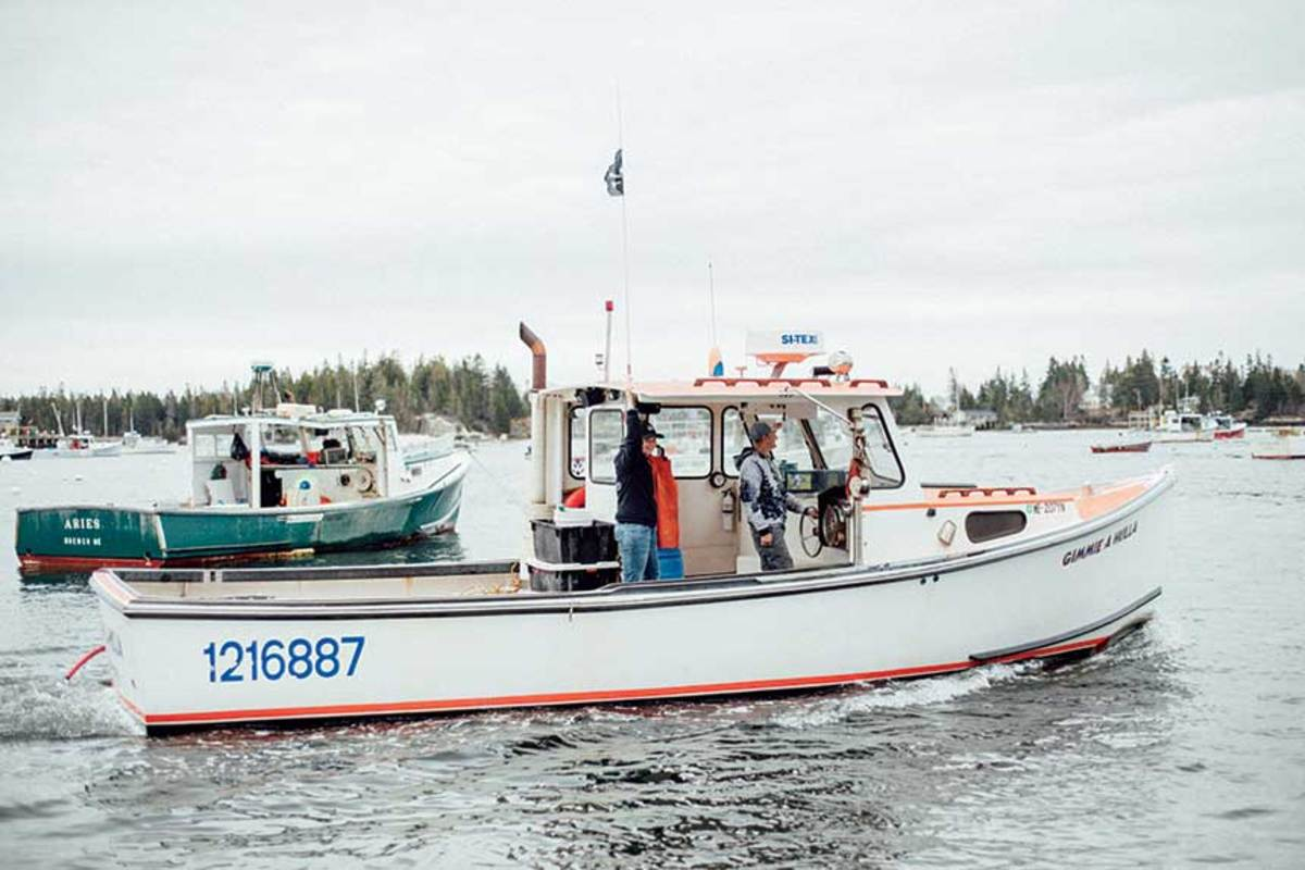 Yvonne Rosen's H&H Marine  Gimmie A Hulla leaves the dock near  her home in Vinalhaven.