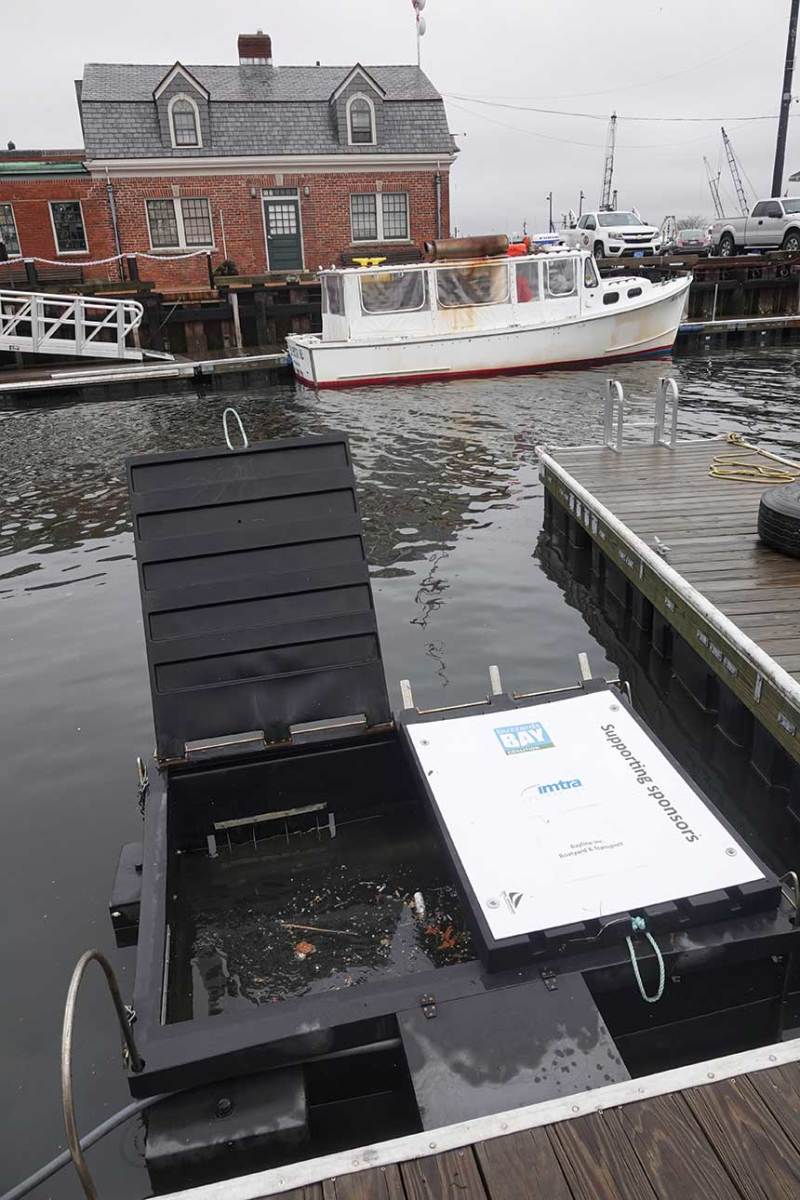 A marine trash skimmer in New Bedford harbor
