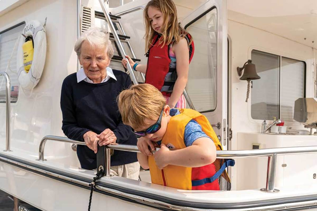 Barbara, Lilly and Jack hang out on deck