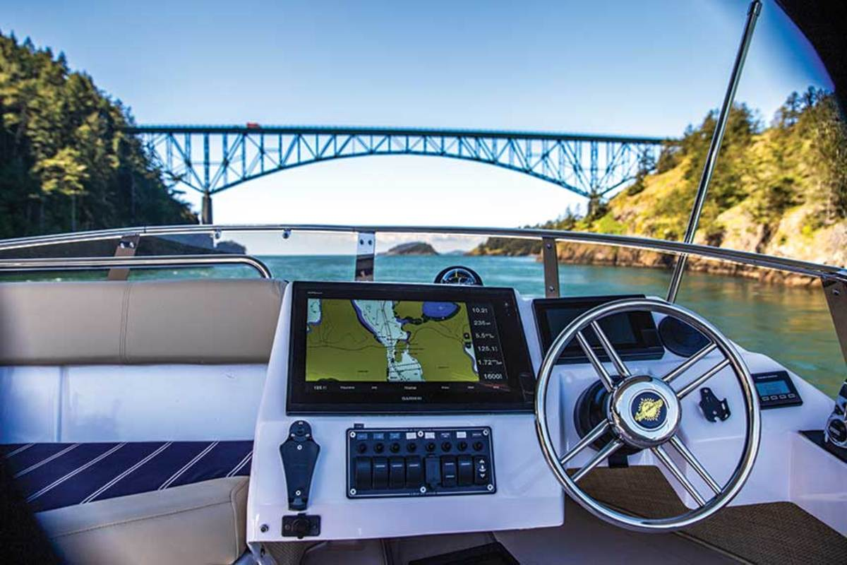 The flybridge helm is one of three steering stations aboard.