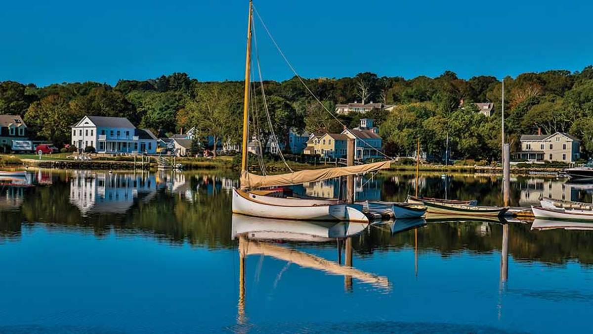 A classic wooden boat looks at home in this postcard-perfect New England town.