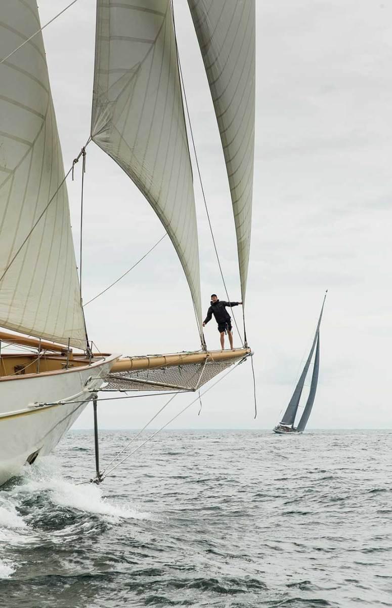 Adix's bowman calls the jib trim from the bowsprit off Newport, Rhode Island.