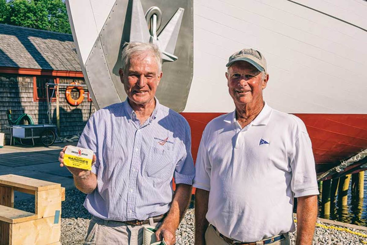 An Underwood descendant presented Taylor Allen (left) with a can of the company's sardines.
