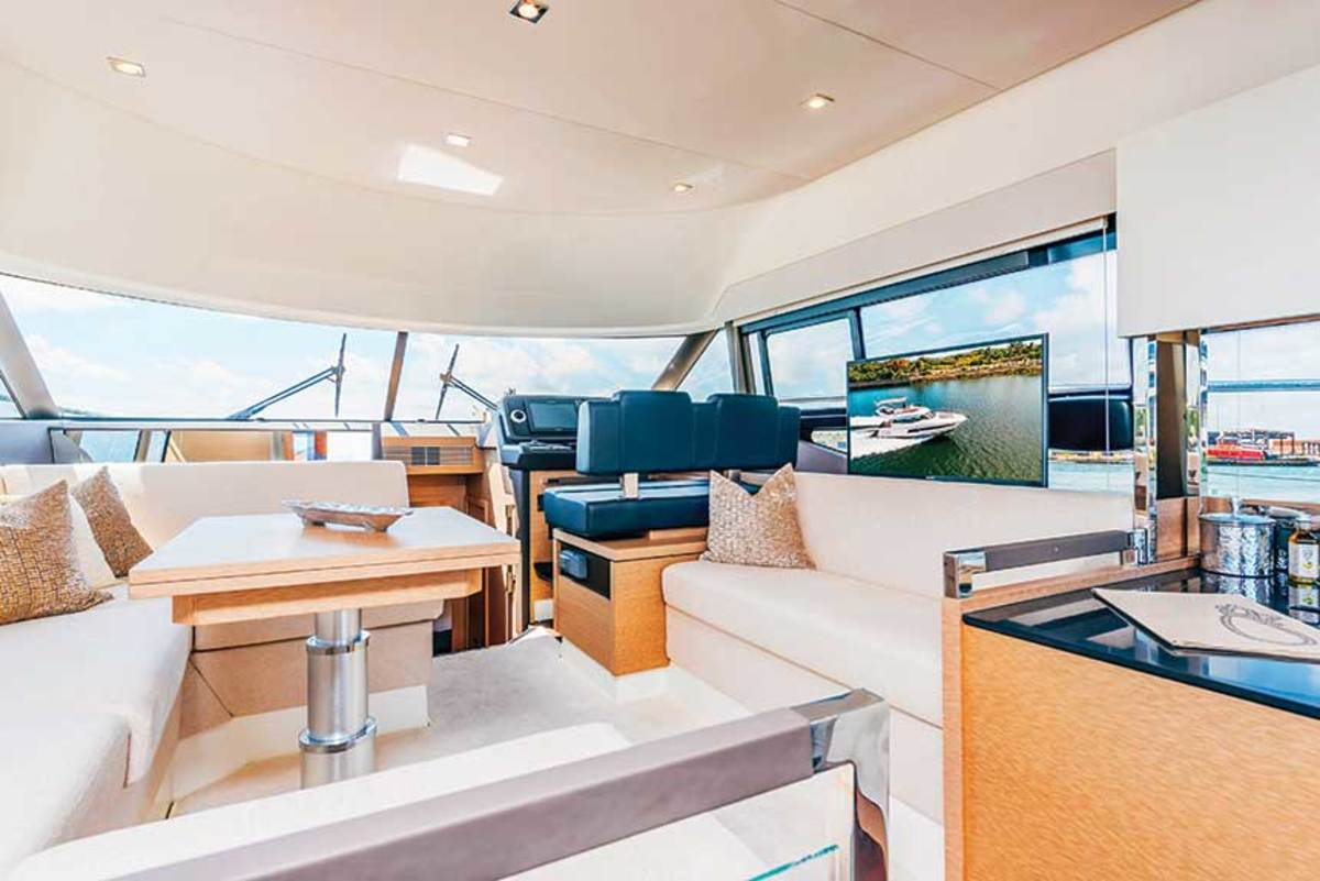 Windows bring a lot of light into the salon, where a dinette is served by the galley aft.