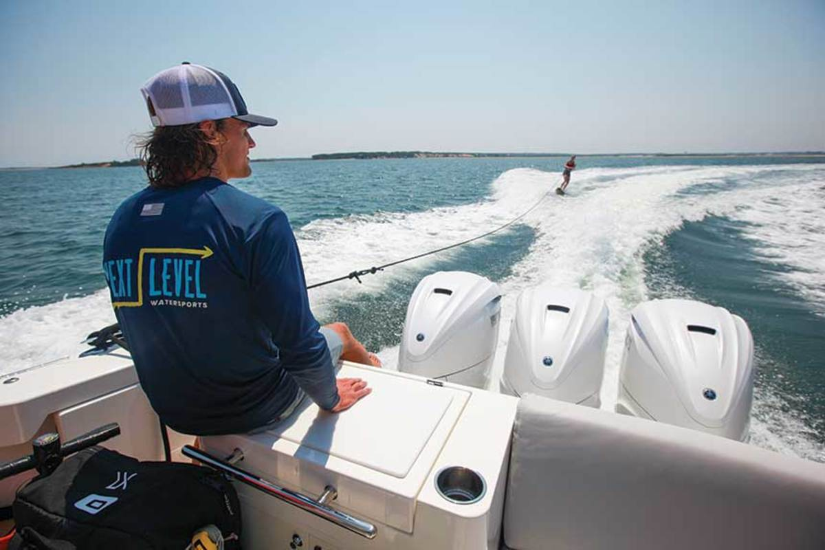 Instructor Ben Sampson  keeps an eye on a wakeboarder at Cape Poge Wildlife Refuge.