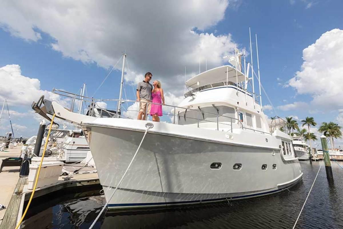 Mark and Kae Edington on the bow of Fusion, their Nordhavn 47