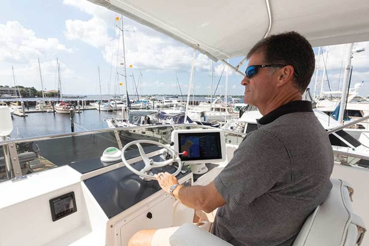 Mark takes command at the flybridge helm.