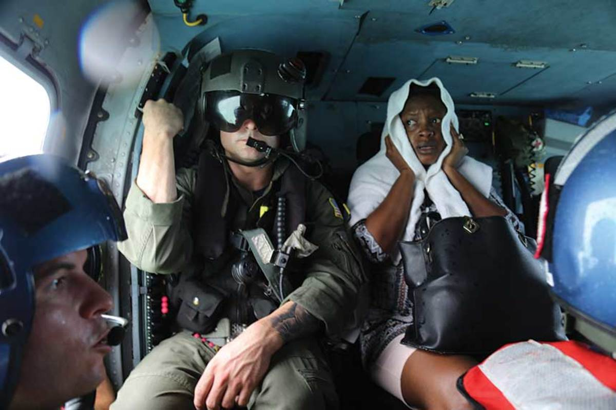 A Hurricane Dorian victim is airlifted from the Abacos by the United States Coast Guard.