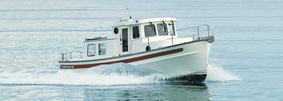 The tiny but tenacious Nordic Tug 26 sleeps four, but is best-suited for a single cruising couple.