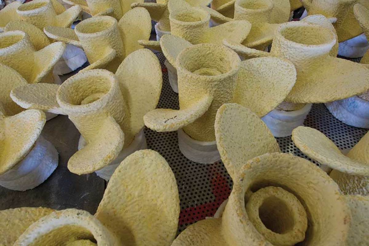 Wax hub and propeller units are coated with refractory slurries and silica sand to form hard molds.