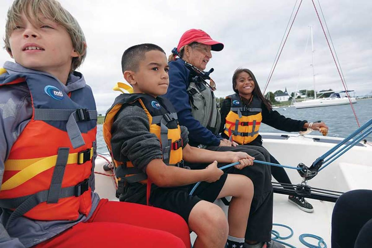 Instructor Mary Finn teaches fourth-graders from Newport, Rhode Island, to sail on one of Sail Newport's J/22s.